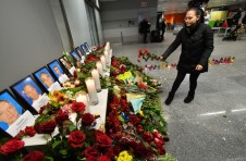 A woman places flowers at a memorial for the victims of the Ukraine International Airlines Boeing 737-800 crash in the Iranian capital Tehran, at the Boryspil airport outside Kiev on January 8, 2020. - A Ukrainian airliner crashed shortly after take-off from Tehran Wednesday killing all 176 people on board, in a disaster striking a region rattled by heightened military tensions. (Photo by Sergei SUPINSKY / AFP)